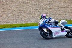 Piloto de Sergio Gadea de 125cc en el MOTOGP imagen de archivo