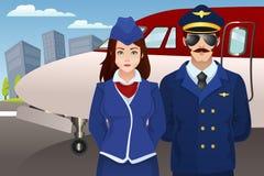 Piloto e aeromoço na frente do avião Imagens de Stock