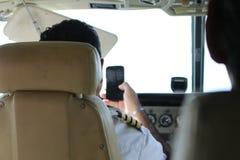 Piloto em Smartphone fotografia de stock royalty free