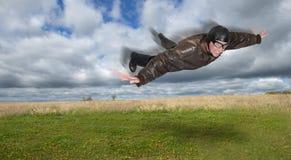 Piloto ou aviador Flying Through o ar Imagens de Stock