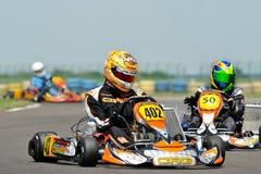 Pilotos desconhecidos que competem no campeonato nacional de Karting Imagens de Stock Royalty Free
