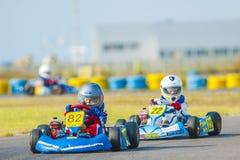 Pilotos que compiten en el campeonato nacional de Karting Foto de archivo