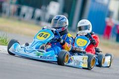 Pilotos que compiten en el campeonato nacional de Karting Imagen de archivo libre de regalías