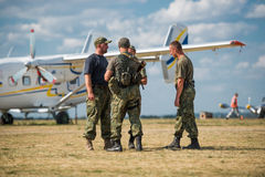 Pilots on aerodrome near airplane at Kharkiv on Royalty Free Stock Photography