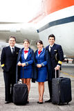 Pilots and air hostesses Stock Image