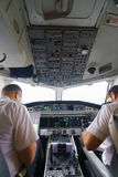 Pilots in aircraft cockpit Royalty Free Stock Photos