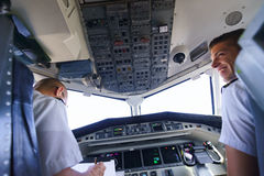 Pilots in aircraft cockpit Royalty Free Stock Photo