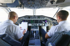 Pilots in aircraft cockpit Royalty Free Stock Images