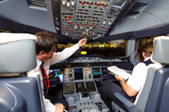 Pilots in aircraft after landing Stock Photography