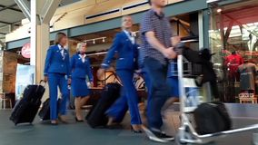 Pilots and airhostess with luggage inside YVR airport. In Vancouver BC Canada stock video footage