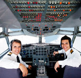 Pilots in an airplane cabin Stock Images