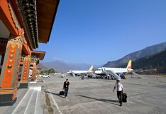Pilots with baggage walking in Paro airport after landing Royalty Free Stock Images