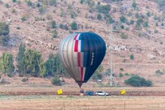 Pilots of a black - grey air hot balloon are preparing to fly out at the festival of air hot balloons. Afula, Israel, 3 August, 2018 : Pilots of a black - grey stock images