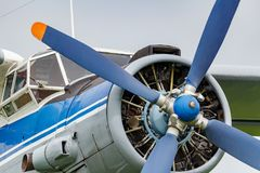 Pilots cabin and engine with four blade propeller of soviet aircraft biplane Antonov AN-2 closeup stock photo