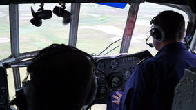 The pilots in the cockpit of a helicopter fly over the tundra. The Yamal peninsula. Summer stock video