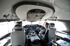 Pilots in the cockpit of Qatar Airways Boeing 787-8 Dreamliner at Singapore Airshow Stock Photo