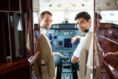Pilots In Corporate Plane Cockpit Royalty Free Stock Images