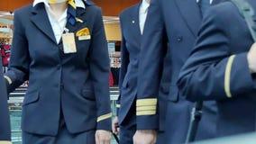 Pilots and flight attendants walking