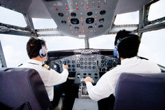 Pilots flying an airplane Royalty Free Stock Photography