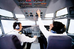 Pilots flying an airplane Stock Images