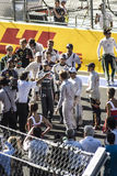 The pilots of formula one gathered together on the starting line Stock Image
