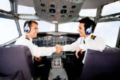 Pilots handshaking Stock Photos