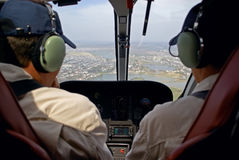 Pilots in helicopter cabin Stock Images
