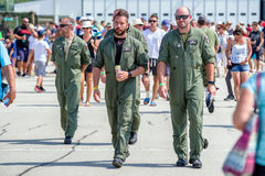 Pilots in overall walking on runway Royalty Free Stock Photos