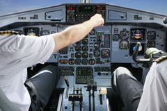 Pilots in the plane cockpit Royalty Free Stock Photo