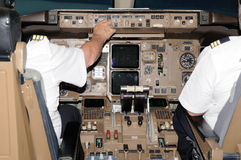 Pilots in the plane cockpit and dusk Royalty Free Stock Photography