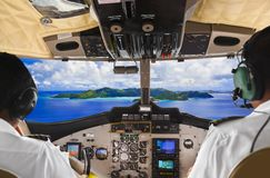 Pilots in the plane cockpit and island Stock Photos