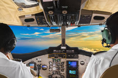 Pilots in the plane cockpit and sunset Royalty Free Stock Images