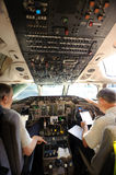 Pilots preparing aircraft for take-off Stock Photography