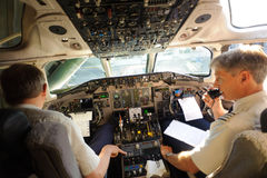 Pilots preparing aircraft for take-off Royalty Free Stock Photography