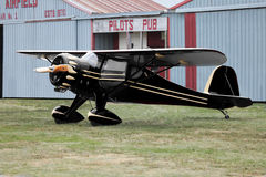Pilots Pub. Antique Airplane in front of old airport hanger and pub Royalty Free Stock Photo