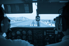 Pilots in the small plane cockpit landing Stock Images