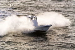 Pilots speed boat chasing ship Royalty Free Stock Photos