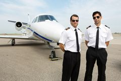 Pilots Standing In Front Of Private Jet Royalty Free Stock Photos