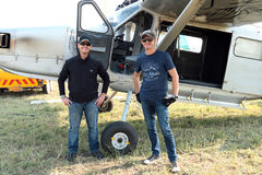Pilots standing next to one of two X328 Atlas Angel Turbine spec Royalty Free Stock Photo