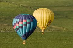 Pilots View of Ballons flying over Fields royalty free stock image