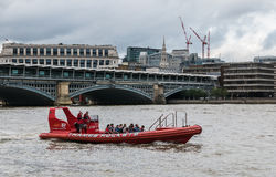 Pilots wave from Thames Rockets tourist boat Royalty Free Stock Photography