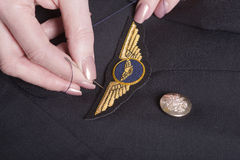 Pilots wings being sewn onto uniform Royalty Free Stock Photography