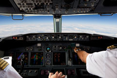 Pilots Working in an Aeroplane. During a Commercial Flight Stock Photos