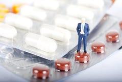 Pils e indústrias de drogas Fotos de Stock Royalty Free