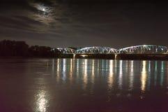 Pilsudski Bridge in Torun on the Vistula. Night view. Moon on the sky stock image