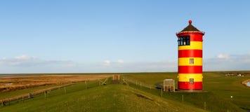 Pilsum, latarnia morska przy Północnym morzem Niemcy Obrazy Royalty Free