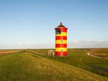 Pilsum, latarnia morska przy Północnym morzem Niemcy Fotografia Royalty Free