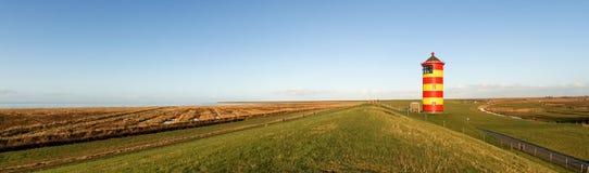 Pilsum, latarnia morska przy Północnym morzem Niemcy Zdjęcie Stock