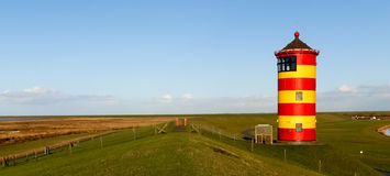 Pilsum, lighthouse at North sea of Germany. Royalty Free Stock Images