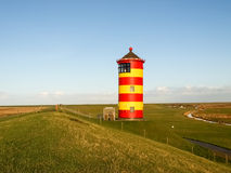 Pilsum, lighthouse at the North sea of Germany. Royalty Free Stock Photography